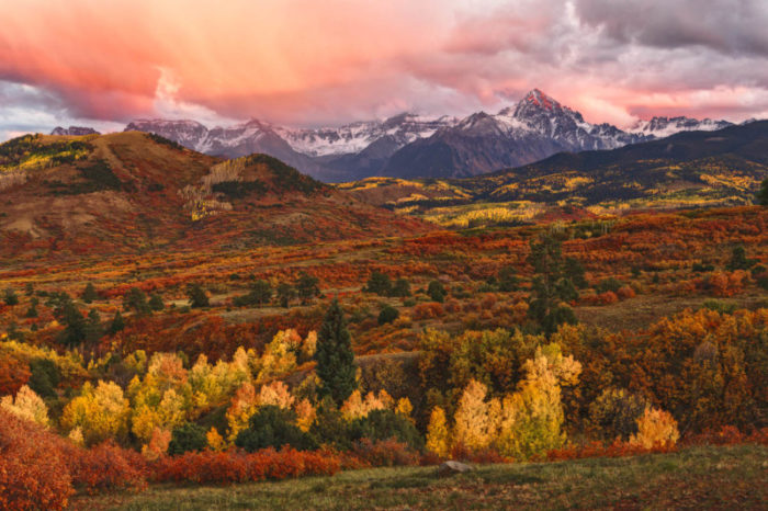 A spectacular sunset erupts over Dallas Divide in the San Juan Mountains of Colorado