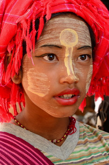 Burma girl with Thanaka paste by Bennett Stevens