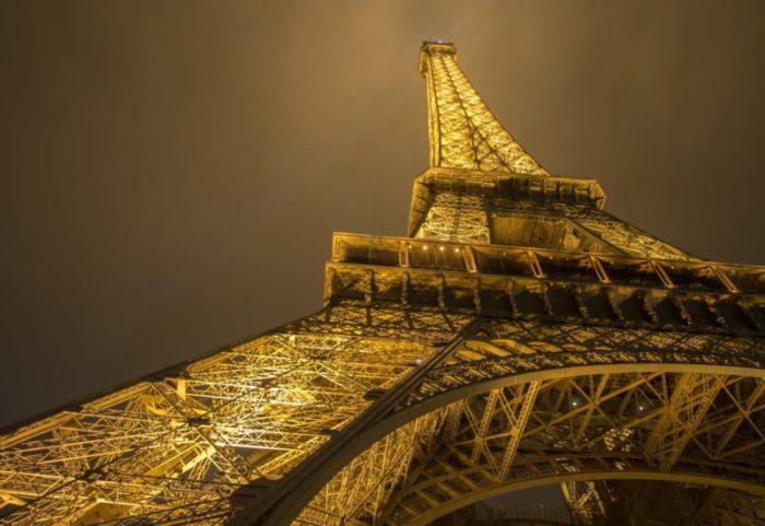 the eiffel tower at night photographed from below during Paris Street Photography Workshop = Wildlife Workshops