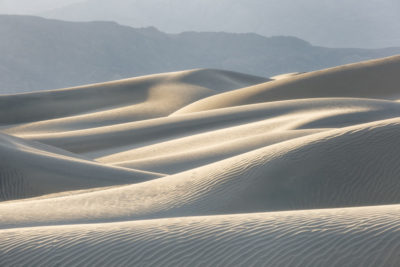 Mesquite Sand Dunes is surrounded by mountains  and sits at the end of the valley floor. The depth of the sand at its highest point is 130-140 feet.  Death Valley National Park, California