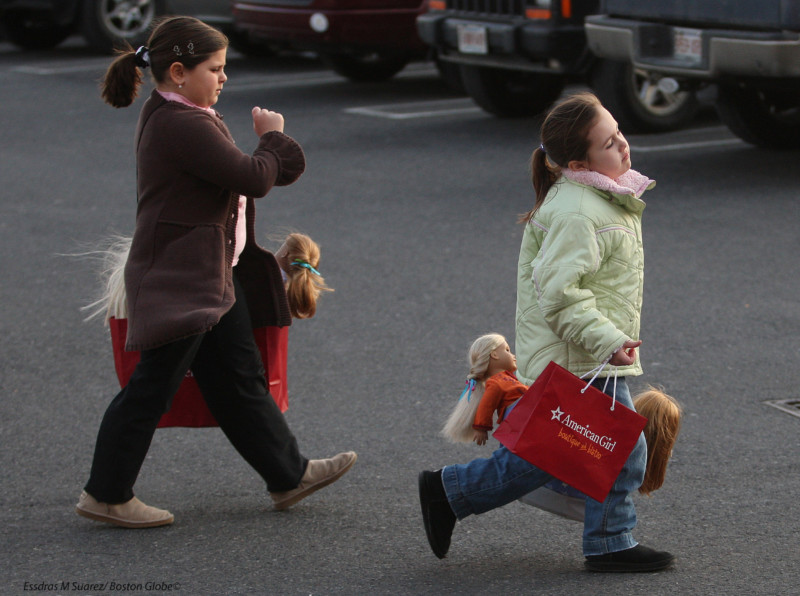 Natick, MA 022009   After a long day of shopping at the American Girl store at  the Natick Collection Mall on February 20, 2009 friends Olivia Norton (Cq), 7, of Norwood (left) and Nicole Smigliani (cq), 7, of Hyde Park head back to their car with bags full of dolls.