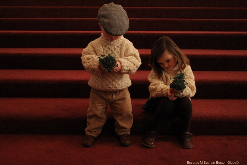 Boston, MA 031710 Siblings Brendan (cq) ,20 month-old,  and Nora (cq), 4, Dowling of West Roxbury  attended the St Patrick's Day mass at the Cathedral of the Holy Cross on March 17, 2010 and examine their shamrock plants after the service. (Essdras M Suarez/ Globe Staff)/ MET